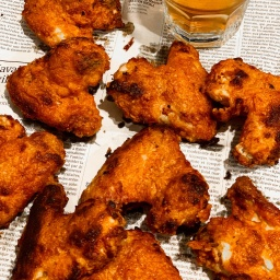 ORANGE & BLACK PEPPER BRINED WINGS WITH BUFFALO SAUCE